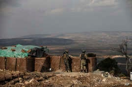Turkish soldiers hold a position atop Bursayah Hill, Afrin region, March 3, 2018, during a Turkish government-organized media tour into northern Syria.