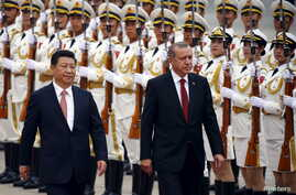 DATE IMPORTED: July 29, 2015 Turkey's President Tayyip Erdogan (R) and his Chinese counterpart Xi Jinping inspect honour guards during a welcoming ceremony outside the Great Hall of the People in Beijing, July 29, 2015.
