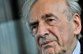 FILE - Elie Wiesel, pictured during an interview in December 2009, survived Nazi brutality to start a career as a journalist. He died Saturday at age 87.