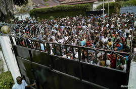 Supporters of the Congolese main opposition party Union for Democracy and Social Progress (UDPS) gather outside the residence of the late veteran opposition leader Etienne Tshisekedi in the Limete Municipality in Kinshasa, Democratic Republic of Cong