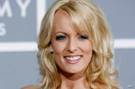 FILE - Stormy Daniels arrives for the 49th Annual Grammy Awards in Los Angeles, Feb. 11, 2007.