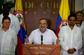 Commander of the Revolutionary Armed Forces of Colombia or FARC, Rodrigo Londono, better known as Timochenko or Timoleon Jimenez talks to the press, accompanied by Ivan Marquez, right, chief negotiator of the Revolutionary Armed Forces of Colombia an