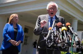 Democratic presidential candidate Sen. Bernie Sanders, I-Vt., accompanied by his wife Jane Sanders, speaks to reporters outside the White House in Washington, June 9, 2016, following a meeting with President Barack Obama.