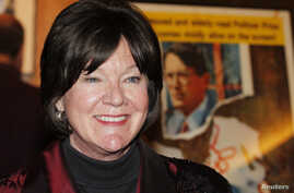 """Actress Mary Badham, who portrayed the character """"Scout,"""" poses at a screening celebrating the 50th anniversary of the Academy Award-winning film """"To Kill A Mockingbird"""" at the Academy of Motion Picture Arts & Sciences in Beverly Hills, California, A"""