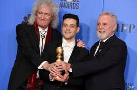 """Brian May, left, and Roger Taylor, right, of Queen, and Rami Malek pose with the award for best motion picture, drama for """"Bohemian Rhapsody"""" at the 76th annual Golden Globe Awards on Sunday, Jan. 6, 2019, in Beverly Hills, Calif."""