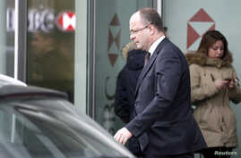 Geneva's Attorney General Olivier Jornot leaves a HSBC Swiss branch of the bank in Geneva, Feb. 18, 2015.
