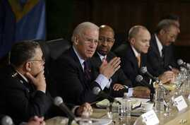 Vice President Joe Biden gestures as speaks after a round table discussion on gun control at Girard College in Philadelphia, Feb. 11, 2013.