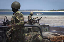 Kenyan army soldiers sit in their armored vehicles. The Kenyan military says it's getting ready to push forward with its offensive against the al-Shabab insurgents, December 14, 2011.