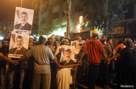 Religious scholars and supporters of deposed Egyptian president Mohamed Morsi take part in an anti-army rally that started from their sit-in area around Raba' al-Adawya mosque, east of Cairo, July 30, 2013.