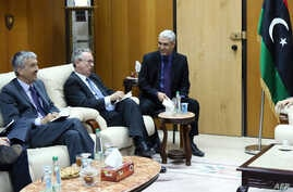 The ambassadors of Spain, Jose Antonio Bordallo (L), of Britain, Peter Millet (2nd L), and of France, Antoine Sivan (3rd L), are welcomed by the Libyan Deputy Prime Minister of the Government of National Accord, Ahmad Meitig (R), in Tripoli on April