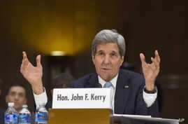 "Secretary of State John Kerry testifies on Capitol Hill, Dec. 9, 2014, before the Senate Foreign Relations hearing on ""Authorization for the Use of Military Force Against IS."""