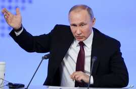 Russian President Vladimir Putin gestures as he speaks during his annual news conference in Moscow, Russia, Friday, Dec. 23, 2016.