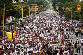Demonstrators take part in a rally to honor victims of violence during a protest against Venezuela's President Nicolas Maduro's government in Caracas, Venezuela, April 22, 2017.