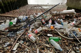 Plastic bottles and other plastics including a mop, lie washed up on the north bank of the River Thames in London, Feb. 5, 2018. European Union officials agreed on Wednesday, Dec. 19, 2018, to ban some single-use plastics, such as disposable cutlery,