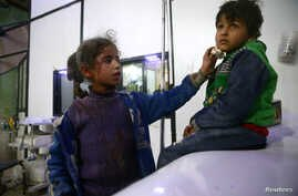 Wounded children are seen in a hospital in the besieged town of Douma, Eastern Ghouta, Damascus, Syria Feb. 23, 2018. A United Nations cease-fire took effect Saturday, and in its early hours relative calm was reported in Damascus and its suburbs.
