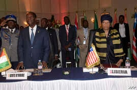 Ivory Coast's president Alassane Ouattara (L) and Liberia's president Ellen Johnson Sirleaf look on during the 49th summit of the Economic Community of West African States (ECOWAS) in Dakar, Senegal, June 4, 2016.