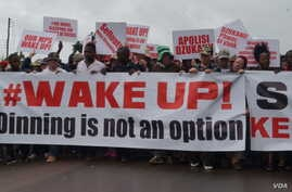 Protesters march in the streets of Malawi's capital, Lilongwe, over continued attacks on albinos.