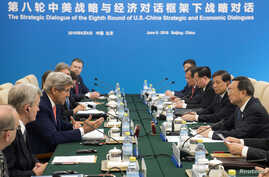 US Secretary of State John Kerry (L) speaks during a session across from Chinese State Councilor Yang Jiechi (R) during a Strategic Track small session as part of the US - China Strategic and Economic Dialogues at Diaoyutai State Guesthouse in Beijin