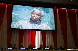 A previous address to the United Nations by former South African President Nelson Mandela is shown on a video screen during an informal meeting of the plenary of the General Assembly to commemorate Nelson Mandela International Day at the United Natio