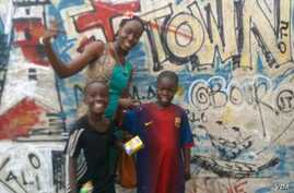 A young iHAVE designer in Accra celebrates the new look with a  couple of her young friends.  (Photo by iHAVE)