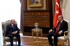 Turkey's President Recep Tayyip Erdogan, right, meets with Devlet Bahceli, leader of the Nationalist Movement Party and his political ally, at the Presidential Palace, in Ankara, April 18, 2018.