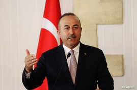 Turkey's Foreign Minister Mevlut Cavusoglu talks at a press conference during a visit in the Turkish Cypriot northern part of the divided city of Nicosia, Cyprus, July 24, 2018.