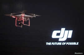 The DJI Phantom 3, a consumer drone, takes flight after it was unveiled at a launch event in Manhattan, New York, April 8, 2015.