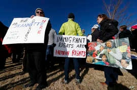 Supporters hold up a placard during a rally in for Jeanette Vizguerra, a Mexican woman seeking to avoid deportation from the United States, outside the Immigration and Customs Enforcement office in Centennial, Colo.