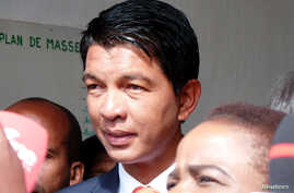 Madagascar presidential candidate Andry Rajoelina leaves the polling center after casting his ballot during the presidential election in Ambatobe, Antananarivo, Madagascar, Dec. 19, 2018.