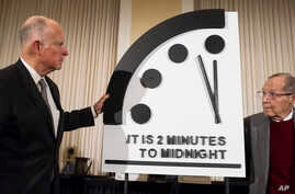 Former California Gov. Jerry Brown (L) and former Secretary of Defense William Perry unveil the Doomsday Clock during The Bulletin of the Atomic Scientists news conference in Washington, Jan. 24, 2019.