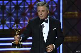 """FILE - Actor-comedian Alec Baldwin accepts an award for Outstanding Supporting Actor in a Comedy Series for """"Saturday Night Live"""" during the 69th Emmy Awards at the Microsoft Theatre in Los Angeles, California, Sept. 17, 2017."""
