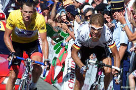 FILE – Lance Armstrong, shown at left in a 2001 Tour de Fr