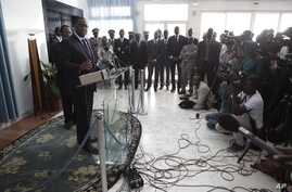 FILE - Senegalese President Macky Sall, front left, responds to journalists' questions during a press conference.