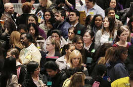 A crowd of job seekers attends a health care job fair in New York, Mar. 14, 2013.