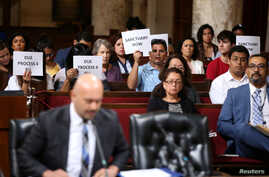 FILE - Immigrant supporters protest during a Los Angeles City Council ad hoc committee on immigration meeting to discuss the city's response to threats by the Trump administration to cut funding from Los Angeles and other jurisdictions that federal o