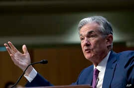 FILE - Federal Reserve Board Chair Jerome Powell testifies on Capitol Hill in Washington, July 17, 2018. Powell gives the keynote address Friday at an annual conference of central bankers in Jackson Hole, Wyo.