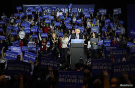 U.S. Democratic presidential candidate Bernie Sanders speaks at his caucus night rally Des Moines, Iowa, Feb. 1, 2016.