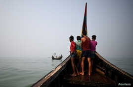 FILE - Rohingya refugees crew a fishing boat in the Bay of Bengal near Cox's Bazar, Bangladesh, March 24, 2018.