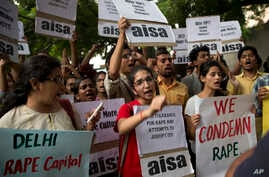Indian students shout slogans during a protest against the latest incidents of rape in New Delhi, India, Oct. 18, 2015.