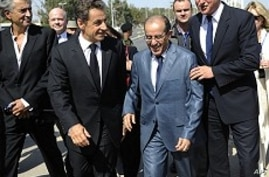 French, British Leaders Vow to Help Rebuild Libya