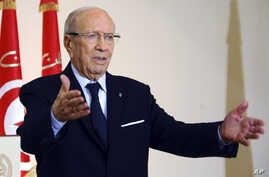 FILE - Tunisian President Beji Caid Essebsi says he and other former officials of the Zine El-Abidine Ben Ali regime are technocrats untainted by past abuses.