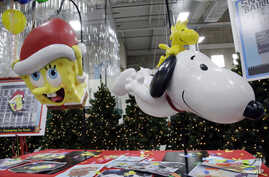Models of a new balloons, Sponge Bob Square Pants, left, and Snoopy with Woodstock, the bird atop, are displayed during a preview of new Macy's Thanksgiving Day Parade floats and balloons in Moonachie, N.J., Nov. 19, 2013.