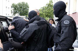 French special forces escort a suspected jihadist from a residential building in Strasbourg, May 13. 2014.