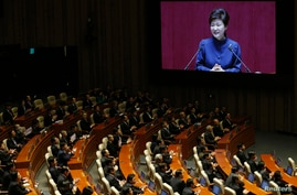FILE - South Korean President Park Geun-hye delivers her speech on the government's 2014 budget proposal during a plenary session at the National Assembly in Seoul.