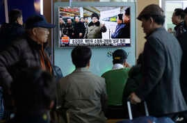 "People watch a TV news program showing North Korean leader Kim Jong Un with superimposed letters that read: ""North Korea has made nuclear warheads small enough to fit on ballistic missiles"" at Seoul Railway Station in Seoul, South Korea, Wednesday, M"