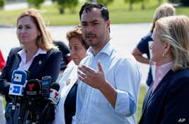Rep. Joaquin Castro, D-Texas, second from right, chairman of the Congressional Hispanic Caucus, speaks during a news conference after touring the Homestead Temporary Shelter for Unaccompanied Children with Rep. Debbie Mucarsel-Powell, D-Fla., left, R