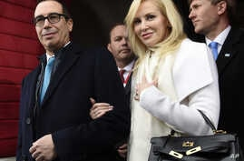 FILE -  then Treasury Secretary-designate Stephen Mnuchin and his then-fiancee, Louise Linton, arrive on Capitol Hill in Washington, for the presidential inauguration of Donald Trump.