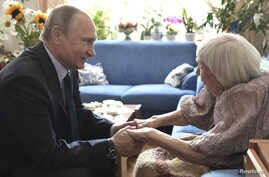 Russia's President Vladimir Putin congratulates the head of the Moscow Helsinki Group, Lyudmila Alekeyeva, on her 90th birthday during a meeting in Moscow, July 20, 2017.