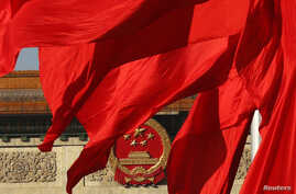 The Great Hall of the People, where the Chinese Communist Party plenum is being held, is seen behinds red flags in Tiananmen Square in Beijing, Nov. 12, 2013.