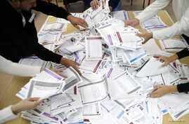 Election Commission officials count votes after presidential and parliamentary elections at a polling station in a school in Zenica, Bosnia and Herzegovina Oct. 7, 2018.